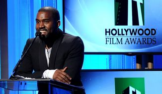 FILE - In this Oct. 22, 2013 file photo, recording artist Kanye West speaks onstage during the 17th Annual Hollywood Film Awards Gala at the Beverly Hilton Hotel in Beverly Hills, Calif.  West has pleaded no contest to misdemeanor battery against a photographer at Los Angeles International Airport last year in a special plea in which he maintains his innocence. West entered the plea through his attorney and did not attend the court hearing Monday, March 17, 2014. (Photo by Frank Micelotta/Invision/AP, File)