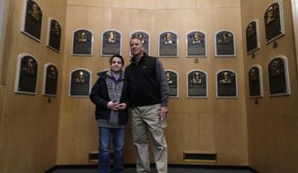 Former Atlanta Braves pitcher Tom Glavine poses for a photo with Benjamin Hrobat of Barrington, R.I., in the Plaque Gallery at the Baseball Hall of Fame on Monday, March 17, 2014, in Cooperstown, N.Y. Glavine will be inducted to the hall in July. (AP Photo/Mike Groll)