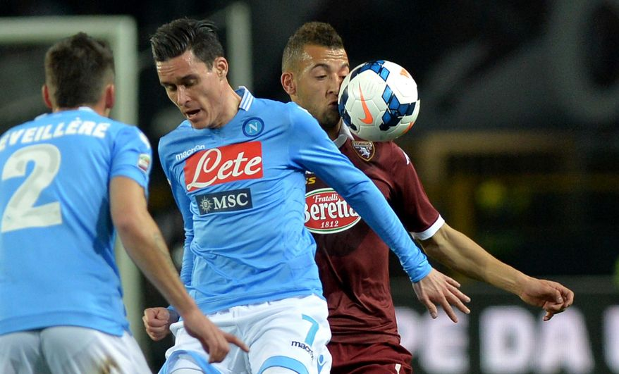Torino midfielder Omar El Kaddouri, right, challenges for the ball with Napoli's Jose Callejon during a Serie A soccer match at the Olympic stadium, in Turin, Italy, Monday, March 17, 2014. (AP Photo/ Massimo Pinca)