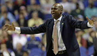 Virginia Tech head coach James Johnson reacts to a call during the second half of a first-round NCAA college basketball game against Miami at the Atlantic Coast Conference tournament in Greensboro, N.C., Wednesday, March 12, 2014. Miami won 57-53. (AP Photo/Gerry Broome)