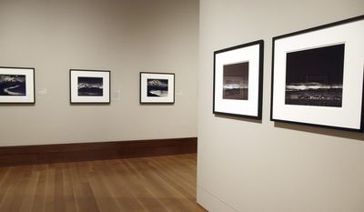"""This March 14, 2014 photo shows a photo exhibit entitled, """"In Focus: Ansel Adams""""  at the J. Paul Getty Museum in Los Angeles. Toward the end of his life, photographer Ansel Adams pored over thousands of negatives he'd carefully kept since his teens and set aside 70 that he considered his best works of art. He offered to sell sets of 25, with strings attached: Adams would select 10 and let buyers choose the other 15; the images printed by Adams himself could never be resold, only left to a museum.  The few dozen who made the cut included the late Leonard and Marjorie Vernon, whose collection was given to the J. Paul Getty Museum and is the centerpiece of """"In Focus: Ansel Adams.""""   (AP Photo/Nick Ut)"""