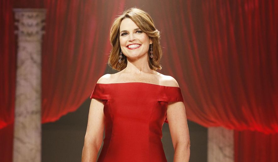 ** FILE ** In this Feb. 6, 2013, file photo, Savannah Guthrie walks the runway at the Red Dress Collection 2013 Fashion Show in New York. (Photo by John Minchillo/Invision/AP, File)