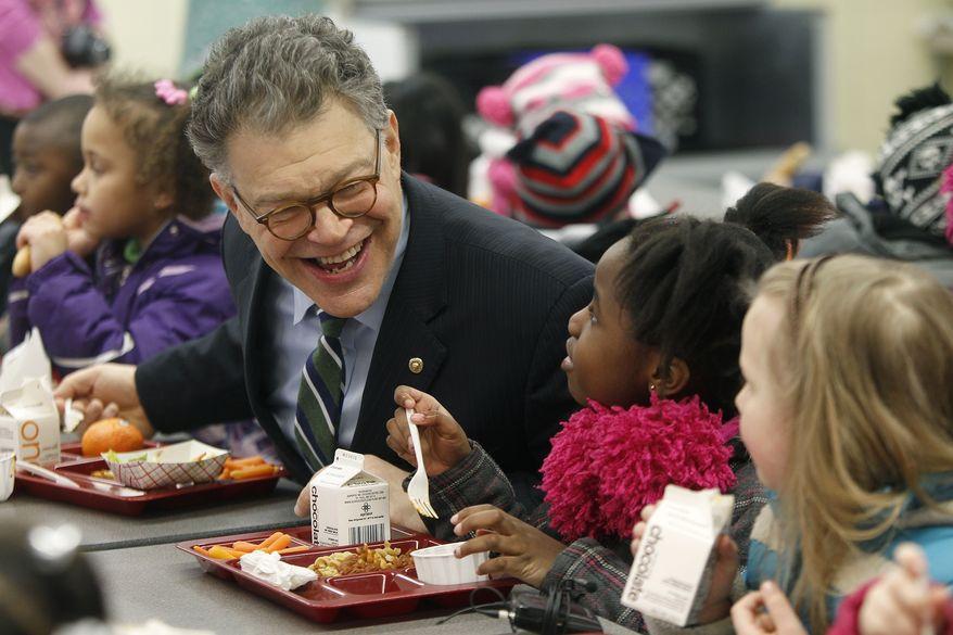 ** FILE ** Democratic U.S. Sen. Al Franken, D-Minn., eats lunch with Meadow Lake Elementary School students, Monday, March 17, 2014, in New Hope, Minn. (AP Photo/Star Tribune, Elizabeth Flores)
