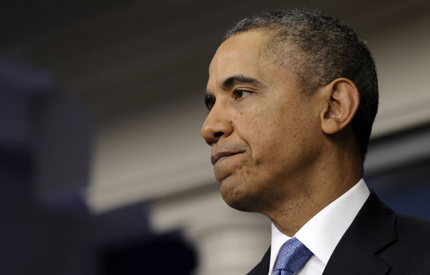 ** FILE ** President Barack Obama pauses while speaking about Ukraine, Monday, March 17, 2014, in the James Brady Press Briefing Room at the White House in Washington. The president imposed sanctions against Russian officials, including advisers to President Vladimir Putin, for their support of Crimea's vote to secede from Ukraine. (AP Photo/Susan Walsh)