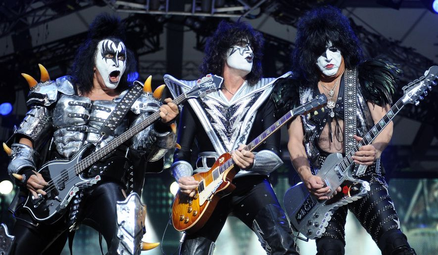 From left, bassist Gene Simmons , guitarist Tommy Thayer and singer Paul Stanley of the U.S. band Kiss perform on stage in Berlin, Germany, June 13, 2013. (AP Photo/dpa,Britta Pedersen)