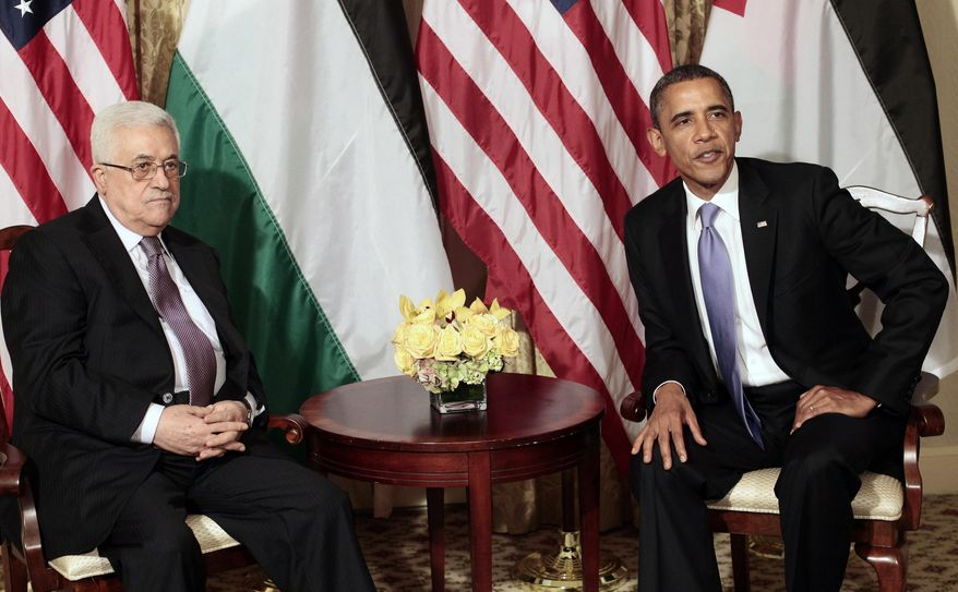 In this Sept. 21, 2011, photo, President Barack Obama and Palestinian President Mahmoud Abbas are seen during a meeting in New York. (AP Photo/Pablo Martinez Monsivais, File)