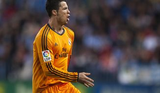 Real Madrid's Cristiano Ronaldo celebrates scoring the opening goal during a Spanish La Liga soccer match at La Rosaleda stadium in Malaga, Spain, Saturday March 15, 2014. (AP Photo/Daniel Tejedor)
