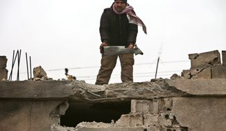 A Lebanese man holds a part of an exploded rocket that hit a house in the predominately Shiite town of Labweh, near the border with Syria, northeast Lebanon, Monday March 17, 2014. Several rockets struck Labweh not far from the predominantly Sunni town of Arsal, causing damage to a house but no casualties. Residents in Labweh said the rockets were fired from Arsal raising tension between the two towns. Angry residents in Labweh closed the main road leading to Arsal with sand barriers preventing people from entering or leaving as about 20 armed Hezbollah manned the roadblocks. (AP Photo/Hussein Malla)