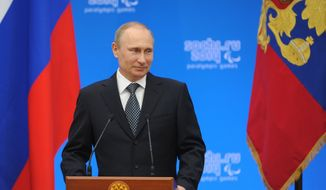 Russian President Vladimir Putin speaks during an awards ceremony in Sochi on Monday, March 17, 2014. Putin is set to speak to both houses of parliament Tuesday about the results of Sunday's referendum in Crimea, in which its residents voted overwhelmingly to break off from Ukraine and join Russia. (AP Photo/RIA-Novosti, Mikhail Klimentyev, Presidential Press Service)