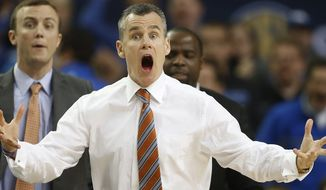 Florida head coach Billy Donovan reacts to play against Kentucky during the first half of an NCAA college basketball game in the Championship round of the Southeastern Conference men's tournament, Sunday, March 16, 2014, in Atlanta. (AP Photo/John Bazemore)