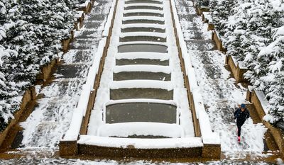 Melissa Almanzar of Washington, D.C. jogs through Meridian Hill Park as the region gets another snow storm, Washington, D.C., Monday, March 17, 2014. (Andrew Harnik/The Washington Times)