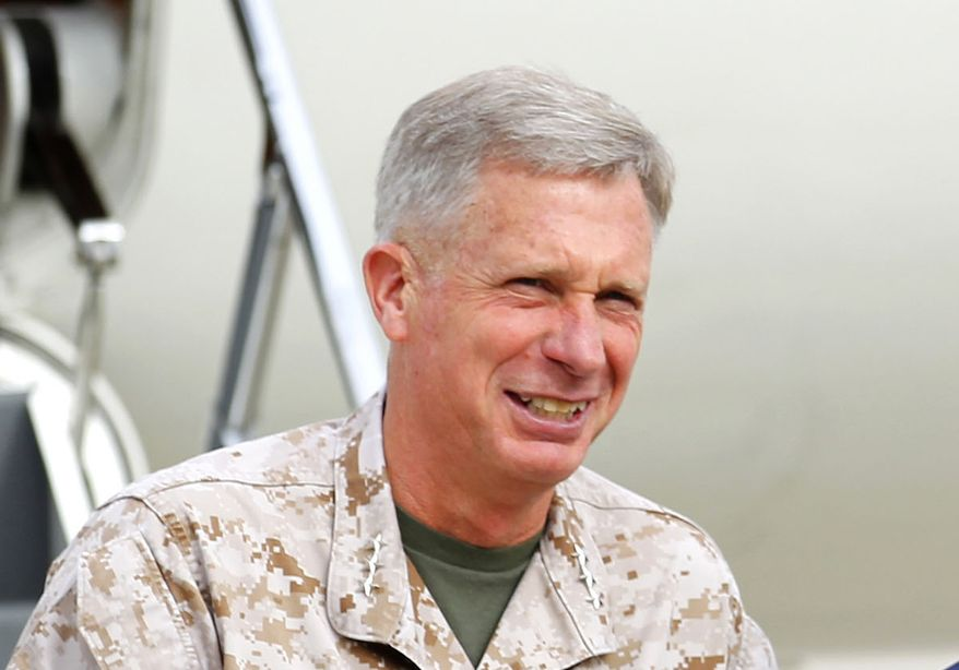 """Lt. Gen. Thomas Waldhauser disclosed that in a one-on-one meeting, Marine Commandant Gen. James F. Amos ordered him to """"crush†all desecration defendants and run them out of the Corps. He said he refused."""