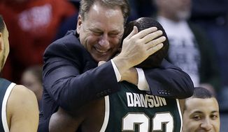 Michigan State guard/forward Branden Dawson (22) hugs head coach Tom Izzo as he walks to the bench in the second half of an NCAA college basketball game against Michigan in the championship of the Big Ten Conference tournament on Sunday, March 16, 2014, in Indianapolis. Michigan State won 69-55. (AP Photo/Michael Conroy)