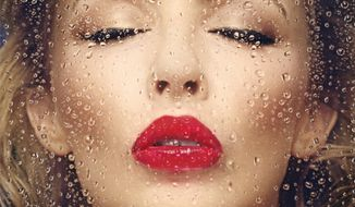 """This CD cover image released by Warner Bros. Records shows """"Kiss Me Once,"""" by Kylie Minogue. (AP Photo/Warner Bros.)"""