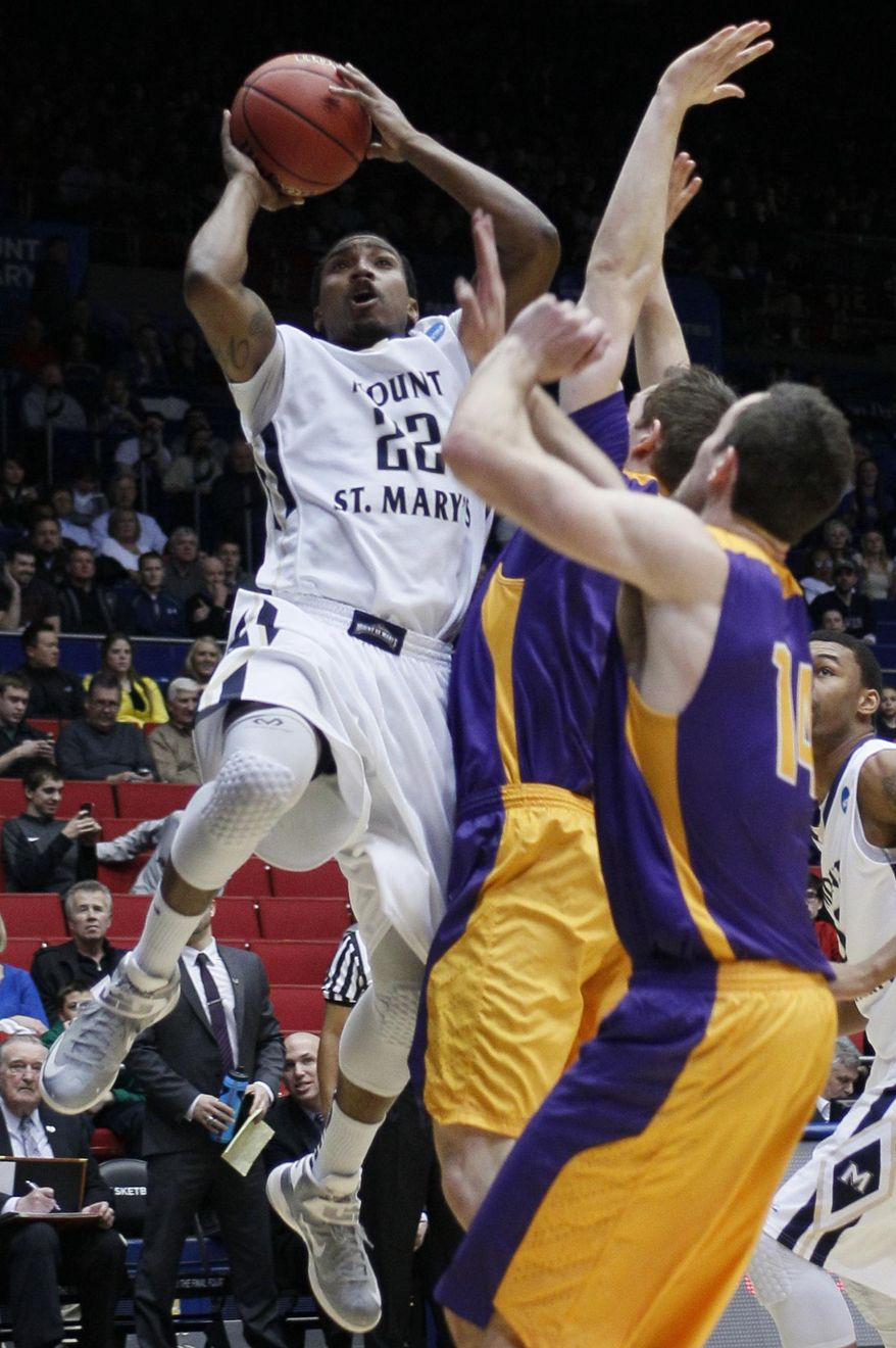 Mount St. Mary's guard Rashad Whack (22) drives against Albany in the first half of a first-round game of the NCAA college basketball tournament, Tuesday, March 18, 2014, in Dayton, Ohio. (AP Photo/Skip Peterson)