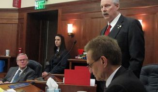 RETRANSMITTING TO REMOVE REFERENCE TO CATHY GIESSEL, WHO IS NOT IN THE PHOTO Sen. Bert Stedman, R-Sitka, top right, speaks on the floor of the Alaska Senate during discussion of proposed amendments to a bill aimed at advancing a major liquefied natural gas project on Tuesday, March 18, 2014, in Juneau, Alaska. Shown in the row in front of him is Sen. Dennis Egan. Seated beside him is Sen. Kevin Meyer. (AP Photo/Becky Bohrer)