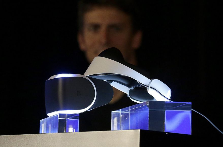 The PlayStation 4 virtual reality headset Project Morpheus is shown on stage as Richard Marks, senior director of research and development at Sony Computer Entertainment America, answers questions at the Game Developers Conference 2014 in San Francisco, Tuesday, March 18, 2014.  (AP Photo/Jeff Chiu)