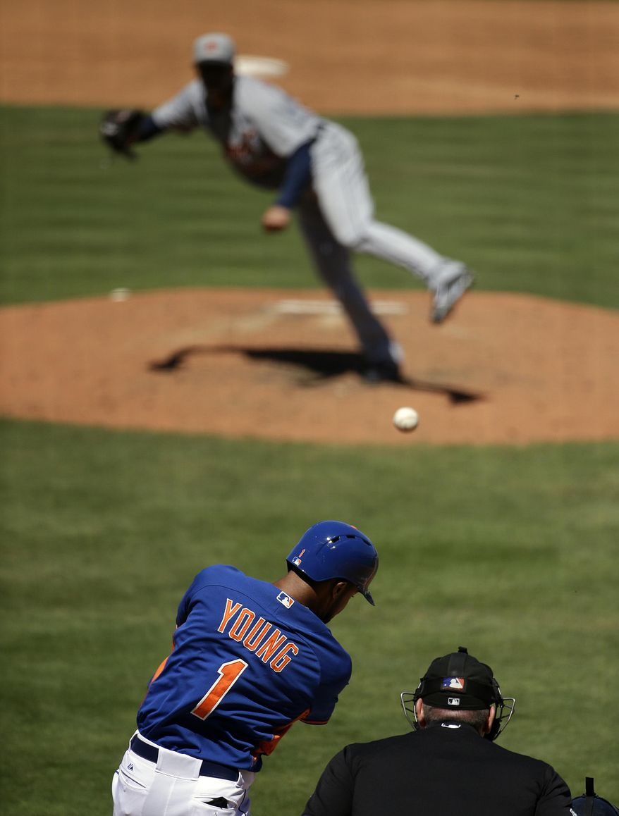 New York Mets' Chris Young, bottom, hits a double off Detroit Tigers pitcher Jose Alvarez to score teammate Juan Lagares in the fifth inning of an exhibition spring training baseball game, Tuesday, March 18, 2014, in Port St. Lucie, Fla. (AP Photo/David Goldman)