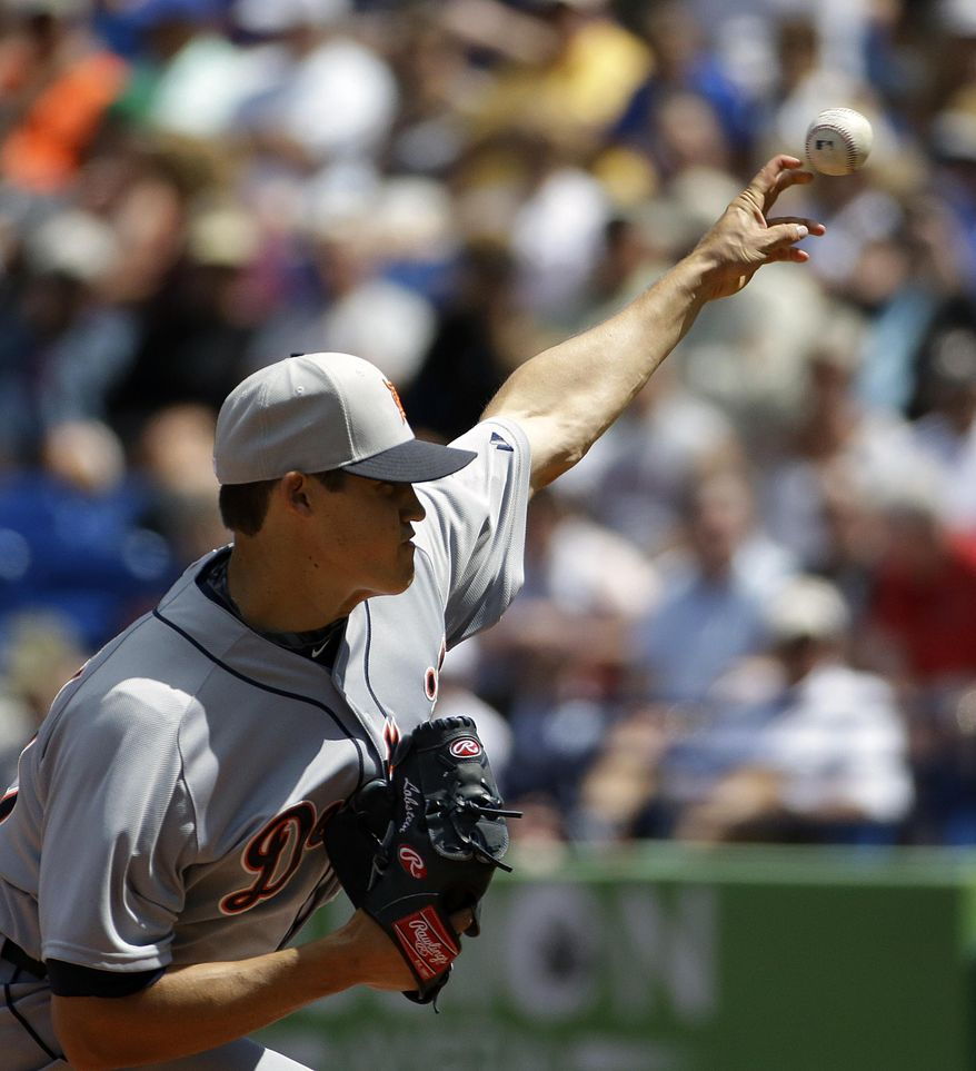 Detroit Tigers starting pitcher Kyle Lobstein throws in the first inning of an exhibition spring training baseball game against the New York Mets, Tuesday, March 18, 2014, in Port St. Lucie, Fla. (AP Photo/David Goldman)