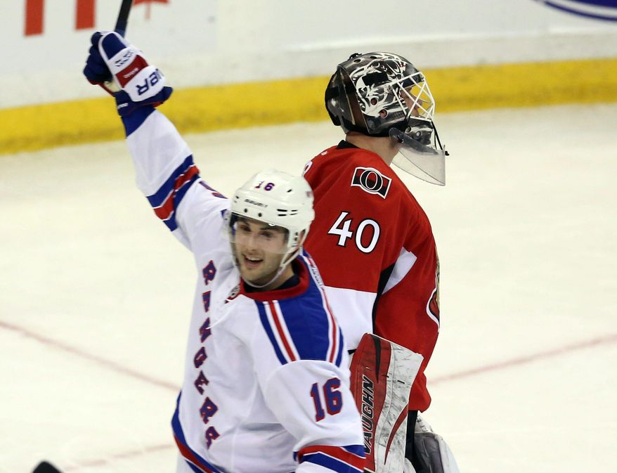 New York Rangers' Derrick Brassard (16) celebrates a goal as Ottawa Senators goaltender Robin Lehner reacts during second period NHL hockey action in Ottawa, Ontario, Tuesday March 18, 2014. (AP Photo/The Canadian Press, Fred Chartrand)