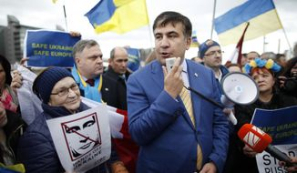 **FILE** Mikhail Saakashvili, the former president of Georgia, speaks March 6, 2014, to a pro-Ukraine rally while walking through Dublin on his way to the convention center. Saakashvili arrived to participate in the European People's Party Congress. About 2,000 delegates gathered at Dublin to attend the congress. (Associated Press)