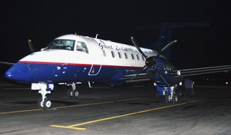 FILE - In this Nov. 1, 2010 file photo, a Great Lakes Airlines passenger plane is seen at the Havre City-County Airport in Havre, Mont. In North Dakota, Great Lakes will suspend service to the Dickinson and Williston airports by the end of the March 2014, after having pulled out of Devils Lake and Jamestown the month before. The Wyoming-based company has said it is pulling out of several regional airports because of problems retaining pilots, citing new federal rules that require co-pilots to log 1,500 flight hours before they can work for commercial airlines. (AP Photo/Havre Daily News, Nikki Carlson, File)