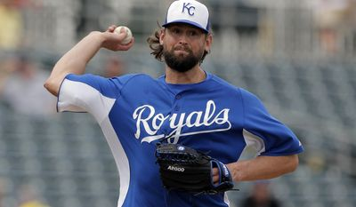 FILE - In this March 5, 2013, file photo, Kansas City Royals starting pitcher Luke Hochevar throws during an exhibition spring training baseball game against the Oakland Athletics in Surprise, Ariz. All over spring training, there's been an outbreak of wrecked elbows and pained pitchers. Hochevar, a reliable reliever for the Royals, felt a twinge on his next-to-last pitch in a game. An MRI revealed a major tear of the ulnar collateral ligament. (AP Photo/Charlie Riedel, File)