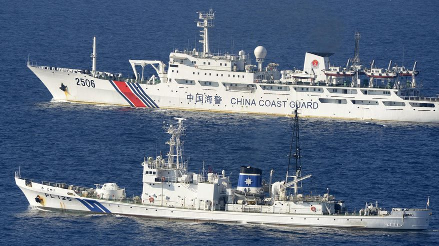 In this Wednesday, Sept. 11, 2013 photo, a China coast guard vessel numbered 2506, top, sails along the Japan coast guard ship Katori in the continuous zone of Japan's territorial waters off the disputed East China Sea islands called Senkaku in Japanese and Diaoyutai in Chinese. A big problem for China is its bad blood with virtually all of its neighbors, many of whom are key players in the search of missing Malaysia Airlines Boeing 777. China has territorial disputes with India, Japan, the Philippines and Vietnam, and many other countries in the region are wary of its efforts to exert more control over Pacific shipping lanes that could impact their freedom of trade. (AP Photo/Kyodo News) JAPAN OUT, MANDATORY CREDIT