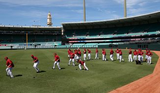 The Arizona Diamondbacks train at the Sydney Cricket Ground in Sydney, Tuesday, March 18, 2014. The Major League Baseball season-opening two-game series between the Los Angeles Dodgers and Arizona Diamondbacks in Sydney will be played this weekend. (AP Photo/Rick Rycroft)