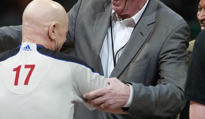 During part of a pre-game ceremony, former Denver Nuggets head coach and player Dan Issel, right, hands the game ball to referee Joey Crawford for tip off as the Nuggets host the Los Angeles Clippers in the first quarter of an NBA basketball game in Denver on Monday, March 17, 2014. Issel was coach of the Nuggets when they defeated Seattle in the opening round of the NBA Playoffs in 1994 to become the first team seeded as eighth in a conference to defeat the top seed. The Nuggets hornored the 1994 team by wearing the uniform from that season to play the Clippers. (AP Photo/David Zalubowski)