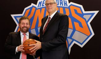 New York Knicks owner James Dolan, left, and new team president Phil Jackson poses for photos during a news conference where he was introduced, at New York's Madison Square Garden, Tuesday, March 18, 2014. (AP Photo/Richard Drew)