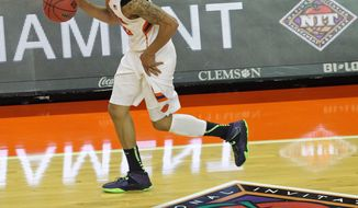 Clemson's K.J. McDaniels dribbles upcourt in the first half of an NCAA college basketball National Invitational Tournament game against Georgia State at Littlejohn Coliseum in Clemson, S.C. on Tuesday March 18, 2014. (AP Photo/Anderson Independent-Mail, Mark Crammer) GREENVILLE NEWS - OUT; SENECA JOURNAL - OUT