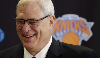 Phil Jackson smiles as he is introduced as the new president of the New York Knicks, Tuesday, March 18, 2014 in New York. Jackson, who won two NBA titles as a player with the Knicks, also won 11 championships while coaching the Chicago Bulls and the Los Angeles Lakers. (AP Photo/Mark Lennihan)