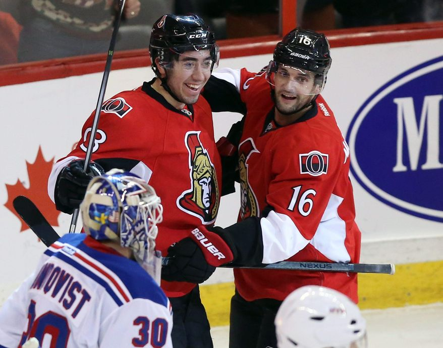 Ottawa Senators' Mika Zibanejad (93)celebrate his goal against the New York Rangers with teammate Clarke MacArthur (16) during first period NHL hockey action in Ottawa,  Ontario, Tuesday March 18, 2014.  (AP Photo/The Canadian Press, Fred Chartrand)