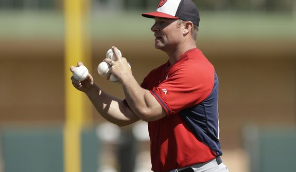 Washington Nationals hitting coach Joe Dillon throws during batting practice of a spring exhibition baseball game against the Houston Astros in Kissimmee, Fla., Sunday, March 16, 2014. (AP Photo/Carlos Osorio)