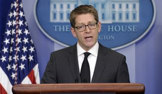 White House press secretary Jay Carney speaks during the daily briefing at the White House in Washington, Tuesday, March 18, 2014. Carney answered questions about Ukraine and Russia. (AP Photo/Susan Walsh)