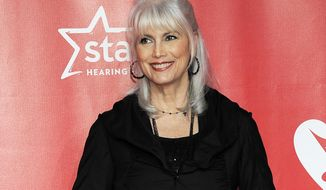 FILE - This Feb. 8, 2013 file photo shows singer Emmylou Harris at the MusiCares Person of the Year tribute honoring Bruce Springsteen in Los Angeles. Blue Rider Press announced that Harris will publish a memoir that will be released in the fall of 2015.  (Photo by Chris Pizzello/Invision/AP, File)