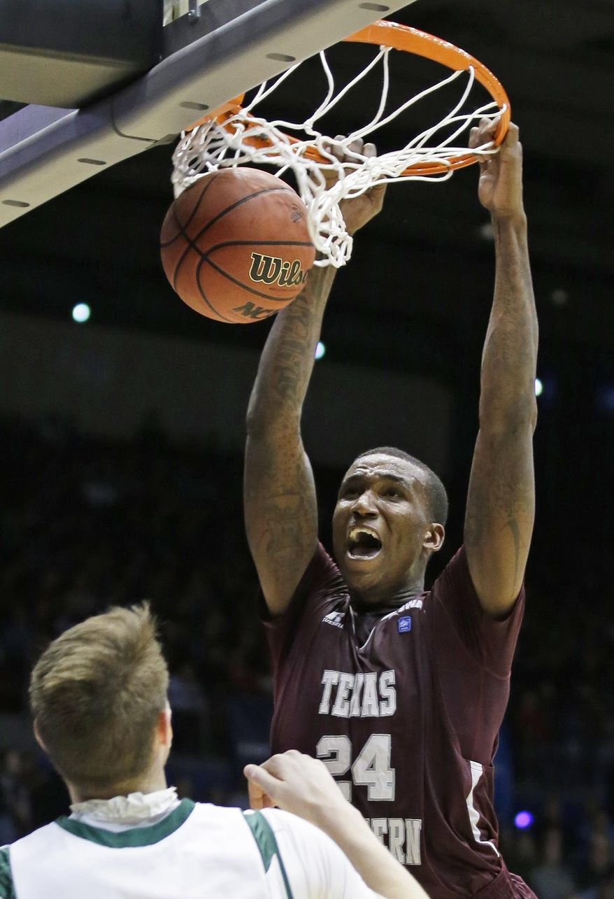 Texas Southern center Aaric Murray (24) dunks against Cal Poly in the second half of a first-round game of the NCAA college basketball tournament on Wednesday, March 19, 2014, in Dayton, Ohio. (AP Photo/Al Behrman)