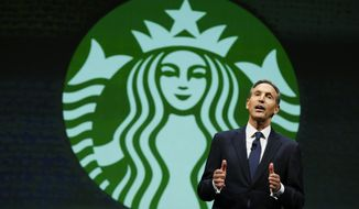 Howard Schultz, chairman and CEO of Starbucks Coffee Company, speaks Wednesday, March 19, 2014, at the company's annual shareholders meeting in Seattle. (AP Photo/Ted S. Warren)