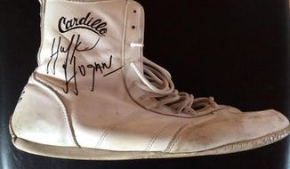 An undated photo provided by the Clearwater Police Department shows an autographed wrestling shoe once worn by wrestler Hulk Hogan that was taken from his shop on Clearwater Beach, Fla., on Sunday, March 16, 2014. The shoe, valued at $5,500, was taken Sunday about 5:20 p.m. by a heavyset white female in her 50s, but the theft was not discovered until Tuesday. Clearwater police are investigating. (AP Photo/Clearwater Police Department)