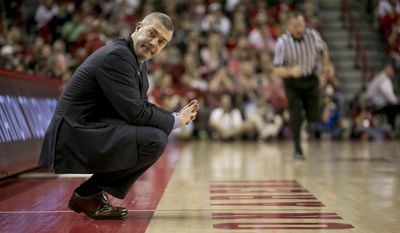 Indiana State head coach Greg Lansing looks to his bench during the second half of an opening round National Invitational Tournament NCAA college basketball game against Arkansas in Fayetteville, Ark., Tuesday, March 18, 2014. Arkansas defeated Indiana State 91-61.(AP Photo/Gareth Patterson)