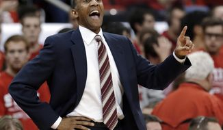 FILE - In this Dec. 18, 2012, file photo, Stanford coach Johnny Dawkins calls to his team during the second half of an NCAA college basketball game against North Carolina State in Raleigh, N.C. If Johnny Dawkins and Craig Neal were still playing _ instead of coaching _ against each other, there's no doubt which one you'd pick. The two will be back on opposing benches Friday night March 21, 2014, 28 years after they faced off as players. (AP Photo/Gerry Broome, File)
