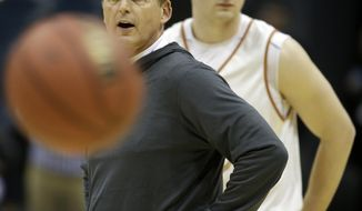 Texas head coach Rick Barnes directs his team during a practice session for their NCAA college basketball tournament game Wednesday, March 19, 2014, in Milwaukee. Texas plays Arizona State on Thursday. At right is Texas forward Brandon Allums. (AP Photo/Morry Gash)