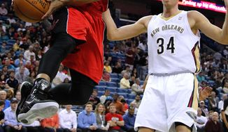 Toronto Raptors guard DeMar DeRozan (10) drives around New Orleans Pelicans center Greg Stiemsma (34) during the first half of an NBA basketball game in New Orleans, Wednesday, March 19, 2014. (AP Photo/Jonathan Bachman)
