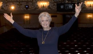 "FILE - This is a Thursday, Jan. 23, 2014 file photo of British actress Angela Lansbury  photographed on stage at the Gielgud Theatre in central London, as she returns to the West End this spring for the first time in nearly 40 years, with the play, Blithe Spirit, by Noel Coward.  Angela Lansbury has British critics spellbound with her performance as a dotty mystic in ""Blithe Spirit"" on the London stage. The 88-year-old performer is appearing as medium Madame Arcati in Noel Coward's supernatural farce. She won a Tony for the role on Broadway in 2009. (AP Photo/Joel Ryan/Invision, File)"