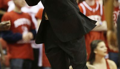 Boston University head coach Joe Jones reacts to a call during the first half of their NCAA mens college basketball game in the first round of the NIT tournament in Boston, Wednesday, March 19, 2014. (AP Photo/Stephan Savoia)
