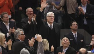 Phil Jackson waves to the crowd as he is introduced during the first half of an NBA basketball game between the New York Knicks and the Indiana Pacers at Madison Square Garden on Wednesday, March 19, 2014, in New York. Jackson was hired as the president of the Knicks this week. (AP Photo/Seth Wenig)