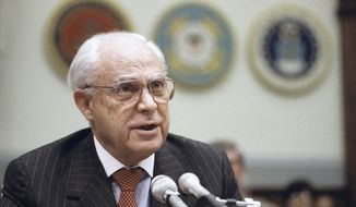 FILE - In this Dec. 11, 1991, file photo, Robert Strauss, U.S. Ambassador to the Soviet Union testifies on Capitol Hill in Washington, before the House Armed Service Committee. Strauss, a former chairman of the Democratic Party and an ambassador to the Soviet Union, has died. Strauss' law firm confirmed his death Wednesday, March 19, 2014, at age 95. (AP Photo/John Duricka, File)