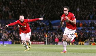 Manchester United's Robin van Persie, right, celebrates scoring their third goal, and his hat-trick against Olympiakos, with team-mate Wayne Rooney, left, during the UEFA Champions League, Round of 16, second leg match at Old Trafford, Manchester, England, Wednesday March 19, 2014.  (AP Photo / Peter Byrne, PA) UNITED KINGDOM OUT - NO SALES - NO ARCHIVES
