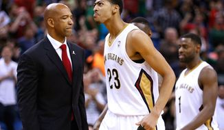 New Orleans Pelicans forward Anthony Davis (23) reacts during the second half of an NBA basketball game in New Orleans, Sunday, March 16, 2014. Davis finished the game with a career high 40 points and 21 rebounds. The Pelicans won 121-120.(AP Photo/Jonathan Bachman)